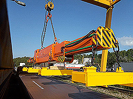 Project crane spreader beam at a stationary crane